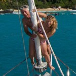 Couple on vacation charter at bow roller